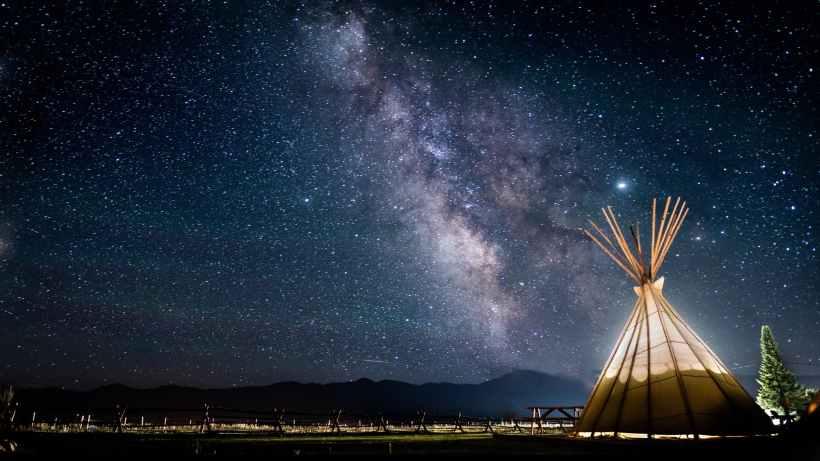 photo of teepee on a starry sky